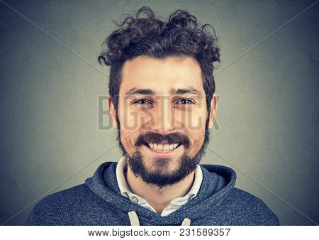Young Hipster Man In Gray Hoodie Smiling Happily At Camera.