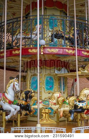merry-go-round, beautiful game for children with colorful horses and fun in an outdoor park