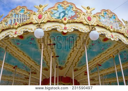 Carousel, merry-go-round, beautiful game for children with colorful horses and fun in an outdoor park