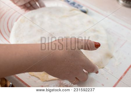 Close-up View Of The Hands Making Potstickers.