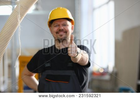 Smiling Worker In Yellow Helmet Show Confirm Sign With Thumb Up At Arm Portrait. Manual Job Diy Insp