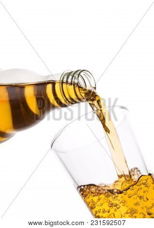 Pouring Fresh Apple Juice From Bottle To Glass On White Background