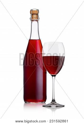 Bottle Of Homemade Red Wine And Glass On White Background With Reflection