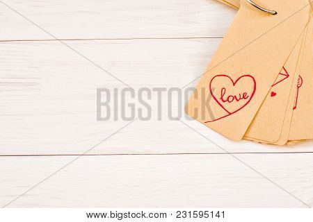 Paper Label With Cute Pink Drawings On White Wooden Background