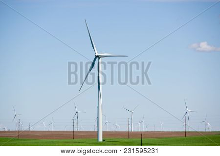 Wind Powered Electricity Generators Sitting In A Field. Located In Eastern Oregon.