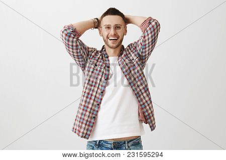 Relaxed Good-looking Brother With Bristle And Glasses Holding Hands Behind Head, Laughing, Feeling F