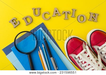 The Concept Of Education. Red Sneakers, School Supplies, Books, Notebooks With Yellow Background.
