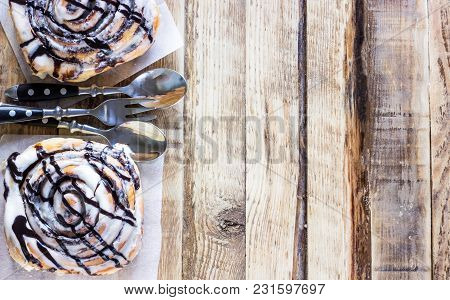 Cinnamon Rolls Or Cinnabons With Cream Sauce, Sweet Traditional Dessert Buns Pastry Food. Top View