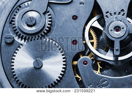 Mechanism Of Old Mechanical Watches With A Pendulum, Gears And Other Details. Selective Focus.