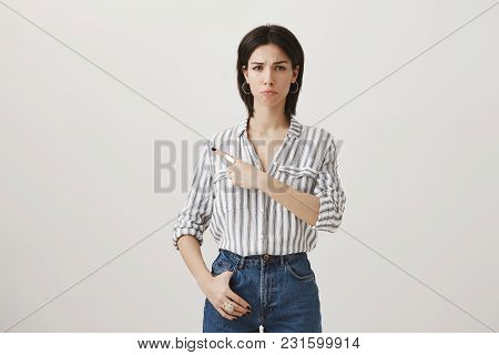 Girl Indicates At Person Who Made Her Mad And Upset. Gloomy Disappointed Young Woman In Stylish Clot