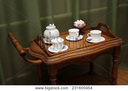 White Tea Set With Sugar In Plate On Wooden Brown Tray