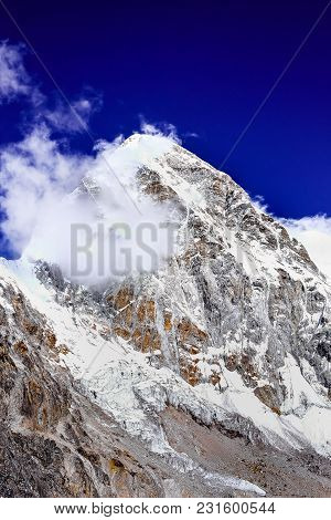 Snow Covered Pumori Mountain Peak, Khumbu Region In Nepal. View Point From The Peak Of Kalapathar. I