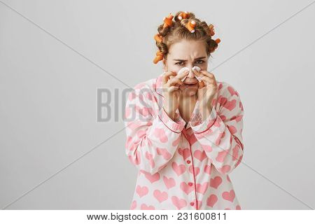 Funny Woman At Home With Hair-curlers, Wearing Pyjamas With Heart Template. Holding Cotton Pads On N