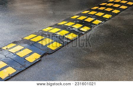 St. Petersburg, Russia - July 31, 2017: Traffic Safety Speed Bump On An Asphalt Road In City Street