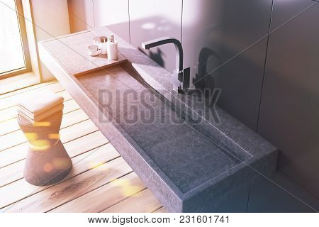Gray Wall Bathroom Interior With A Long Dark Gray Sink And A Chair With Towels. A Top View. 3d Rende