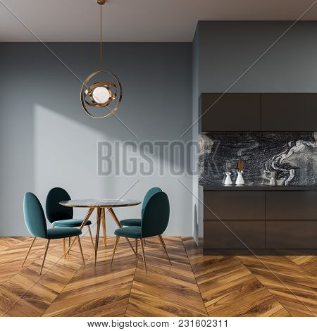 Gray Wall Dining Room And Kitchen Interior With A Wooden Floor, A Round Table And Blue Chairs. 3d Re