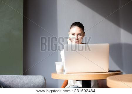 Woman Professional Business Content Writer Working On Laptop Computer During Coffee Break In Cafe Ba