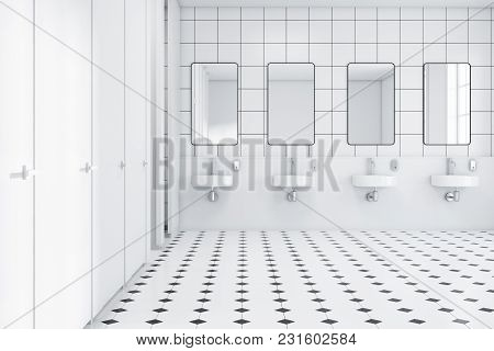 Public Restroom Interior With White And White Tiled Walls And Floor And A Row Of Sinks With Mirrors
