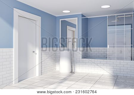 Blue And White Brick Bathroom Interior Idea. A Tiled Wooden Floor, A Round Sink With A Vertical Mirr