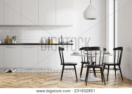 White Dining Room And Kitchen Interior With A Wooden Floor, A Round Table And Black Chairs. 3d Rende