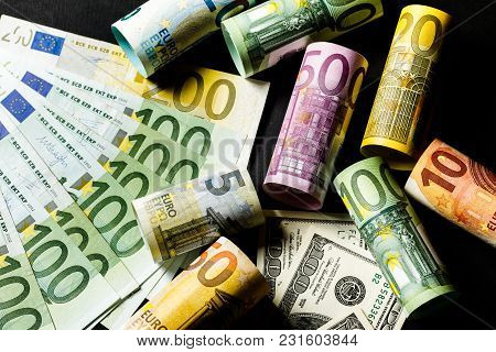 Concept Of Currency Exchange Trading. . Roll Of Hundred Us Dollar Bills .