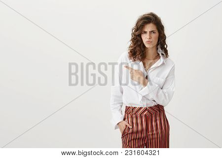 See Yourself What I Can Not Stand. Attractive Caucasian Woman With Curly Hairstyle In Fancy Trousers