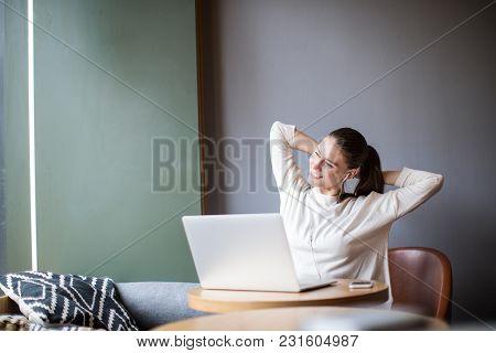 Satisfied Female Freelancer Having Pleasant Fatigue After Work In Internet Via Laptop Computer Sitti