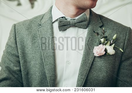 A Groom In Grey Suit And White Shirt Preparing For The Event, Light Background