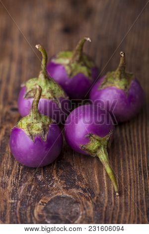Bunch Of Asian Eggplant On Dark Wood
