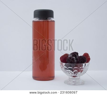 Plastic Bottle. Bottle On White Isolated Background. Bottled With Juice. Sports Bottle