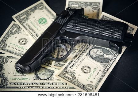 Black And Chrome Gun Pistol And Money Dollars Background