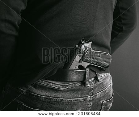 Gangster Concealing His Gun Behind His Back. Back And White Photo
