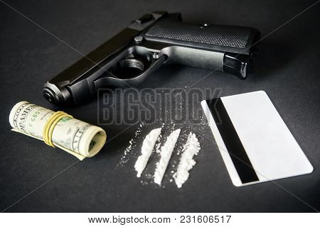 Drug Dealer - Gun, Money, Drug On Black Table