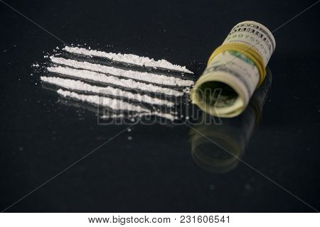 The Hard Drugs With Money On Dark Table