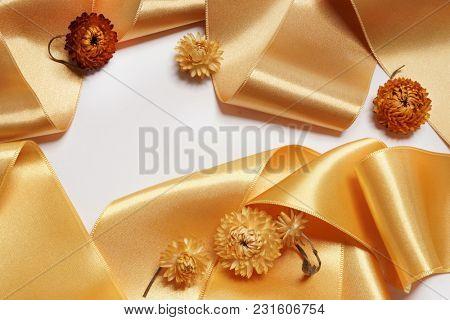 Fashionable satin golden ribbon. Fashion silk.