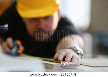 Arms Of Worker Measuring Wooden Bar Closeup. Manual Job Diy Inspiration Improvement Job Fix Shop Yel
