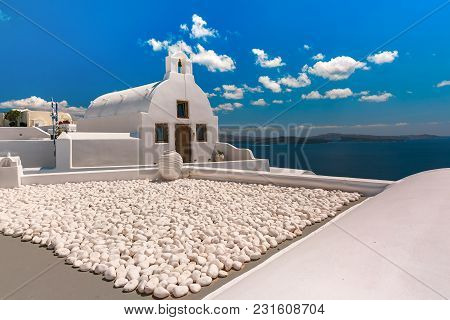 Picturesque View Of White Church In Oia Or Ia, Island Santorini, Greece