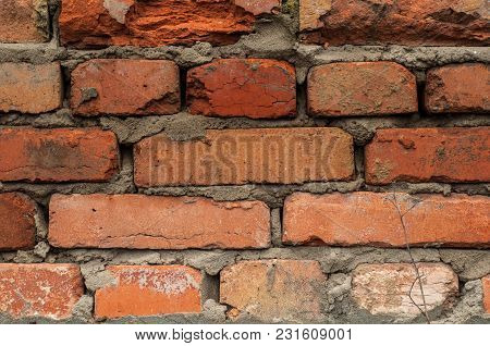 Background From An Old Wall Piled With Red Bricks Close-up