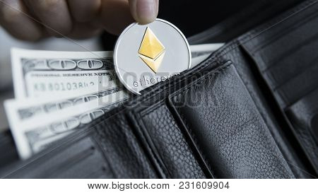Ethereum Coin And Hundred Dollars Bills In Leather Wallet. Ethereum With Dollar In Purse. Profit Fro