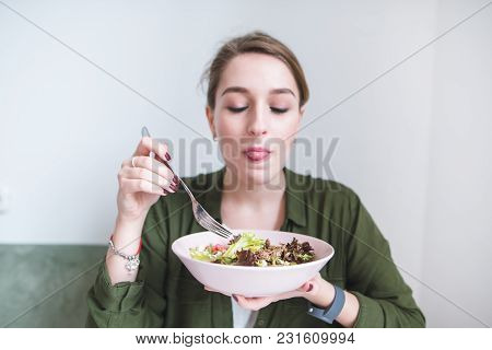 A Cute Woman Eats A Plate Salad. Correct And Delicious Food. Healthy Food. Enjoy The Useful Food.