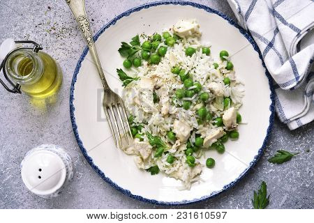 Rice With Chicken And Green Peas.top View .