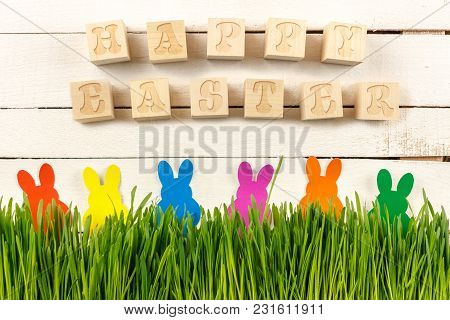 Happy Easter. Cubes With Text On A White Background. Fresh Sprouts And Easter Bunnies.  Ready Postca