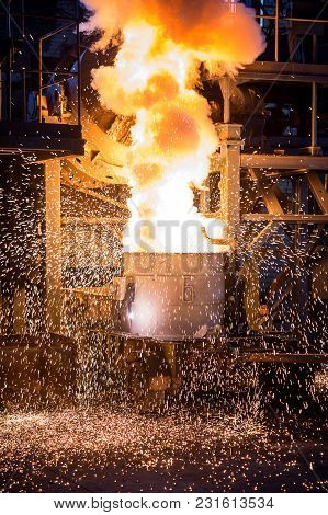 Water Molten Metal Being Pouredpouring Cast Iron Into The Converting Furnace To Produce Steel