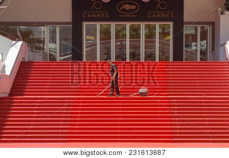 Cannes, France -- May 19, 2017: A Man Vacuums The Iconic Red Carpet Steps Ahead Of Festivities At Th