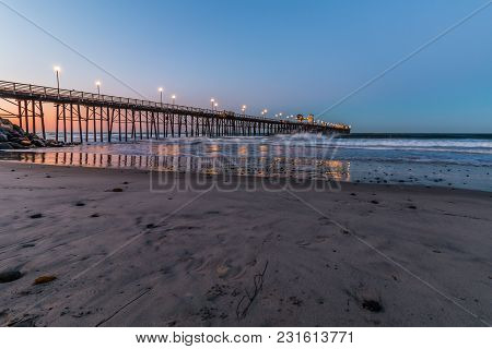 The Oceanside, California Fishing Pier At Dawn, Located In San Diego County.
