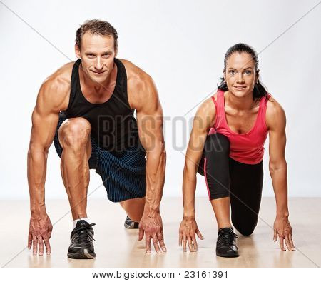 Athletic man and woman doing fitness exercise poster