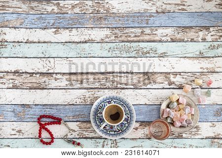 Ramadan And Eid Background With Turkish Coffee, Turkish Delights, And Red Rosary