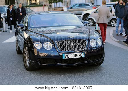 Monte-carlo, Monaco - March 17, 2018: Man Driving An Expensive Black Bentley Continental Gt Coupé In