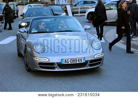 Monte-carlo, Monaco - March 17, 2018: Man Driving An Expensive Gray Porsche 911 997 In Monaco, Coupl