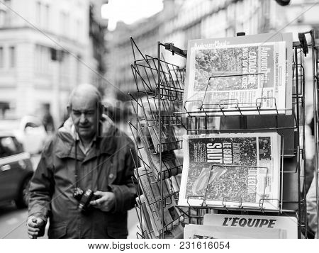 Paris, France - Oct 28, 2017: Senior Man Next To French International Newspaper With News From Spain